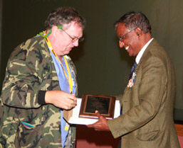 Steve Stache receives his award from Dr. Vasu Melepati