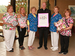 Volunteers Donate Dignity Robes to MVH Cancer Center photo